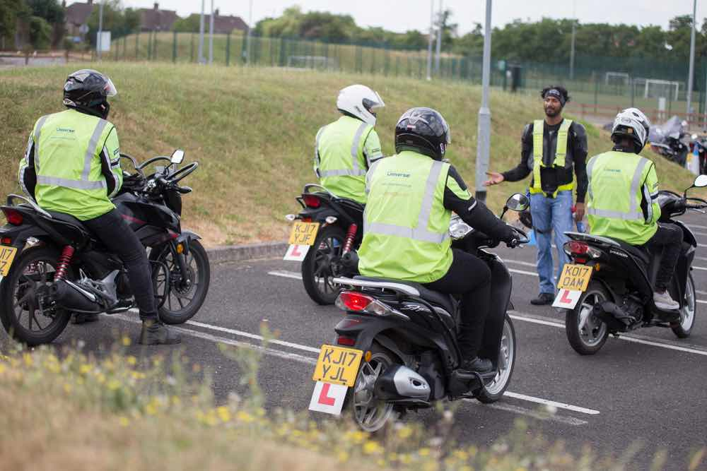 Instructor working with four riders