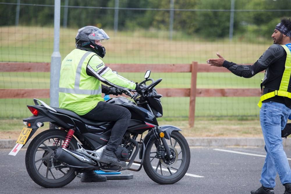 Rider with instructor getting instruction