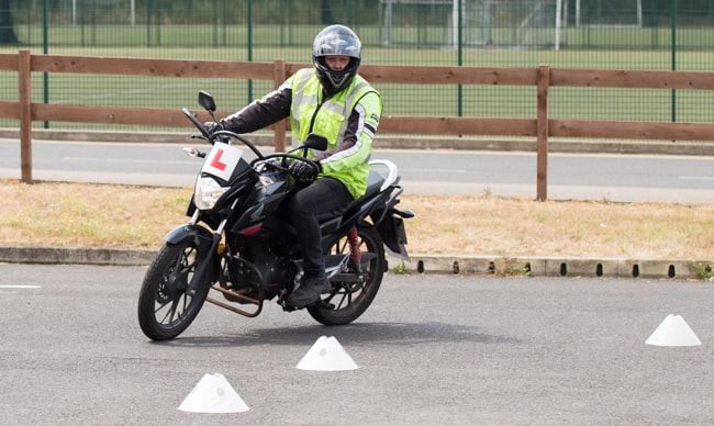 Cbt test trainee riding through cones